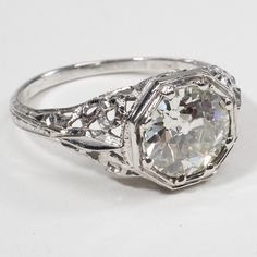 Pretty Engagement Ring #ring...like the shape...with the triangular ends to the central stone