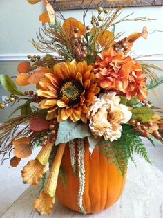 "Use a ""carvable"" craft pumpkin & silk floral stems for this arrangement for fall. Love it."