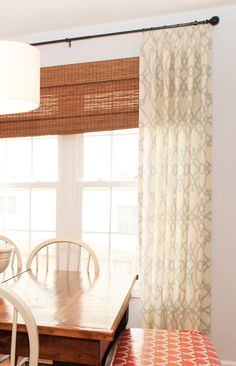Relaxed window treatments and beautiful table with bench
