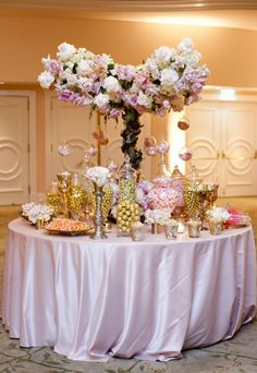 Candy Station: Pink linens, gold and pink sweets, with lavender, gold and pink flowers.