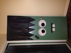 """My door decoration for Halloween....""""Frankie"""" only took about 20 minutes and was around $10.00! :) Easy and cheap...can't beat that. And I know the kids will love it!"""