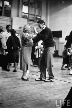 Hempstead High School English teacher Mary Church teaching freshman student how to dance in the school's gym. New York, 1958