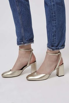 Style up your feet in metallic leather with this strappy pair. With flared heels and an almond toe. #Topshop