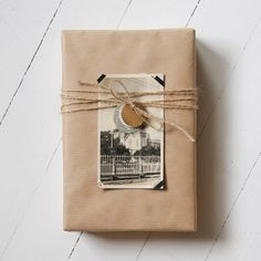 Lovely. Will have to pick up some of those random antique store vintage photos for gift wrapping like this #Gifts