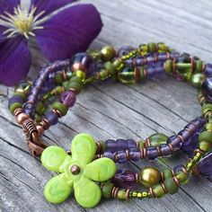 Flower bracelet by Lune. I love the copper jump rings used as spacer beads. #jewelryinspiration #primabead