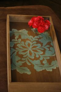 Coffee table tray- I can see myself doing this with a plain try, stencil and some paint.