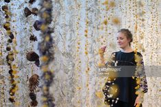 Artist Rebecca Louise Law poses with her new installation 'Life in Death' at Kew Gardens on October 5, 2017 in London, England. The artwork, comprising of around 375,000 preserved flora suspended on copper wire is on display in the Shirley Sherwood Gallery of Botanical Art.