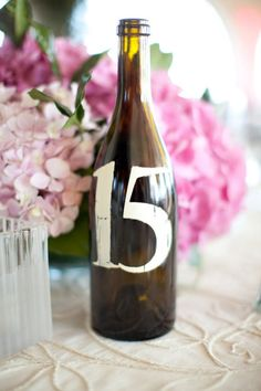 Painted Wine Bottles for Table Numbers  Read more - http://www.stylemepretty.com/2011/10/18/montecito-country-club-wedding-by-jenna-marie-photography-xoxo-bride/