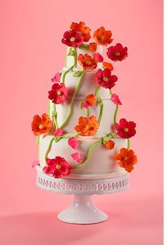 four tier wedding cake with green vines, red and orange flowers from top to bottom ~ Im going to make this for my momma <3