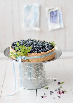 Charmingly beautiful Fresh Blueberry Pie...it's not as it appears. Instead it'a filled with caramel, cheese & vanilla and has a rustic crust I'm curious to try. Might make a delightful treat sometime.