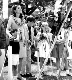 Former first lady Jacqueline Kennedy spent seven weeks in Hawai'i with her children, Caroline and John Jr,. in the summer of 1966. Mrs. Kennedy has her arm around John Jr. Caroline was on crutches because she had cut her foot on coral. In this photo, Mrs. Kennedy had just placed a wreath at the statue of King Kamehameha.   IMAGE FROM THE HONOLULU ADVERTISER ARCHIVES