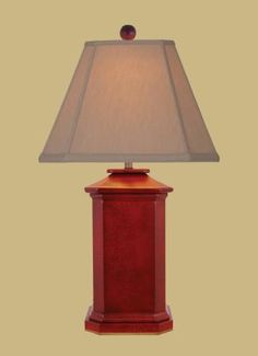 This lamp features a crackled oxblood finish. Perfect for those looking for a pop of red!