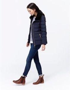 Blue jeans, brown chelsea boots, Joules raincoat