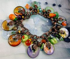 Note: Use pennies made before 1981 for safety purposes.  Read this blog -Sharilyn Miller: Enameled Penny Charm Bracelet