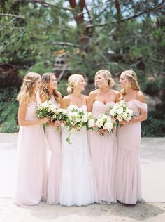 Floor-Length Blush Bridesmaid Dresses | Bella Bridesmaids | Holly Flora | Amsale Flagship Salon https://www.theknot.com/marketplace/amsale-flagship-salon-new-york-ny-626429 | Troy Grover Photography https://www.theknot.com/marketplace/troy-grover-photographers-newport-beach-ca-335623