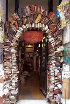 Bookstore Entrance, Lyon, France photo via besttravelphotos...I wonder if the books in the arch are still readable?