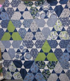 Here is a sample of the Lotus quilt by Jaybird Quilts made using the new and fabulous Hex 'n More ruler!  Most of the fabrics are blue and whites from Dear Stella.  Pattern, ruler, and fabrics all available at Bright Hopes Quilting, Mandeville, LA, 985-845-9554!