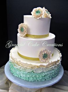 Elegant Ivory Butter Cream Wedding Cake with a Mint Green Ombre Ruffle and Ranunculus