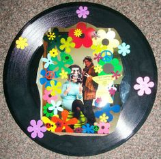 """Take a 60's inspired picture and frame it in an old record!  Decorate it with flower power. (from: Super Saturday""""The 1960's: From Beatles to Bell Bottoms"""" 2.8.2014)"""