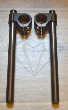 """Universal 22mm(7/8"""") Clip-On Handlebar Set - Fits most models with 35mm Fork Tubes DESCRIPTION: These clip-ons are the perfect choice for providing an excellent look at a great value. They're construc"""