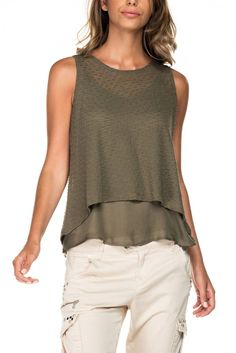 Sleeveless top in a lightweight green knitted fabric, with a viscose cami underneath. Hemline of cami falling below top. Flared A line style. Occasion Wear, Special Occasion Dresses, Trendy Tops, Knitted Fabric, Fashion Boutique, Hemline, Party Dress, Tank Tops, Lady