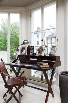love writing desk and chair, large windows with day light everywhere