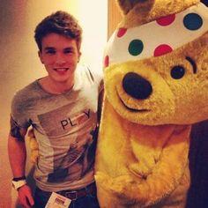 Josh and a very scary bear with a random bandana  over one his eyes.... ok??