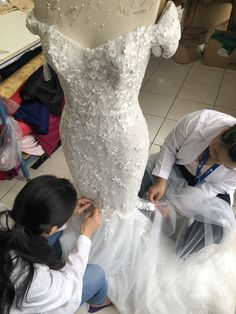 Our seamstresses at Euphorie Studios hand sewing/hand appliqué gowns for our brides. #weddingdress #dresses #dress