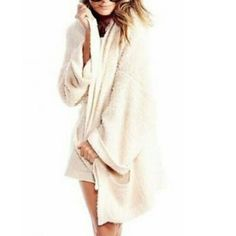 Wildfox Essentials Slouch Cardigan Ivory A must have!! So cuddley, warm, and cozy. Ivory WF cardigan, sold out. This is a small NWT. Also have this in black but a Medium. Just not wearing like I thought I would. Been buying Posh pieces that are my favorite WF instead. Need to sale for more Wildfox Wildfox Sweaters Cardigans