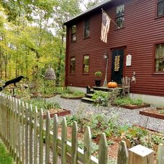 <3.  love this sweet & simple raised bed garden, hanging bee skep & crow keeping watch; corn dryer on the door...of course a flag...and it must be fall...cause I spy a PUMPKIN!
