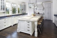white cabinets, gray counters, white island, cape cod pulls