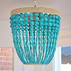 Ro Sham Beaux: Malibu 12, 12 x 12 x 15 Beaded chandelier in turquoise swirl, ice, soapstone, cokebottle, and white swirl with hemp lining. 36'' of chain and canopy included. $748- $1,248. To order, call us at 843-641-7087.