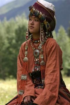 Nomads Kirghiz girl in traditional costume…Kirghistan, Central Asia.