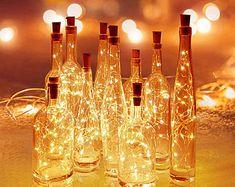 Wine Bottle Fairy Lights, Wine Bottle Corks, Led Fairy Lights, Lighted Wine Bottles, Led String Lights, Wine Bottle Candles, Gin Bottles, Glass Bottles, Copper Wire Lights