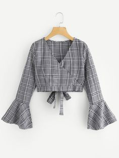 Shop Fluted Sleeve Bow Tie Back Wrap Top online. SheIn offers Fluted Sleeve Bow Tie Back Wrap Top & more to fit your fashionable needs. Netted Blouse Designs, Saree Blouse Designs, Blouse Styles, Teen Fashion Outfits, Stylish Outfits, Cool Outfits, Fashion Dresses, Stylish Blouse Design, Vetement Fashion