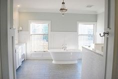 Love the color (soft greynwalls, white cabinets, white tub, white subway tile)