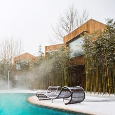 A steaming hot spring is screened behind bamboo shoots at this hotel near Beijing