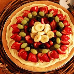 Fresh Fruit Dessert Pizza~some other options~an all strawberry pizza drizzled w/ white chocolate or banana drizzled w/ milk or dark chocolate.  Any others, please post. Thanks!!
