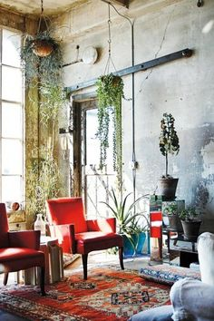 Urban vintage... hanging plants, red accent armchair --- modern bohemian boho interior design / vintage and mod mix with nature, wood-tones and bright accent colors / anthropologie-inspired chic mid-century home decor: