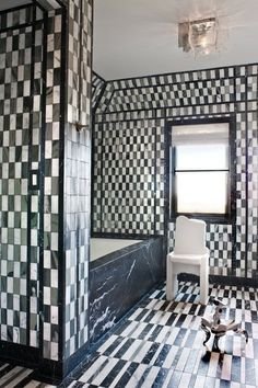 """""""A graphic pattern can ignite a small room,"""" Wearstler writes. She proves her point in this bathroom, creating a vibrant space with only three shades of marble on the floor and walls."""
