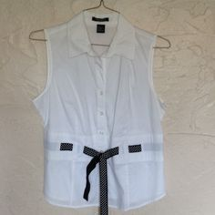 Blouse Sleeveless cotton/spandex blouse. White with a black and white polka dot ribbon @ waist. Autograph Tops Button Down Shirts