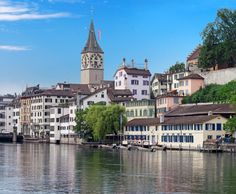 Limmat River, Zurich, Switzerland - we traveled here in 1976ish. I was just a kid but I remember the snow capped mountains, the beautiful green grass and amazing tulips.