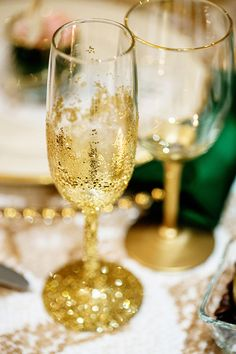 Gold sparkly glasses and table setting. Champagne and Emerald Wedding Ideas from Sugar Branch Events