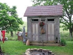 This would make a cute garden shed ~ I'm assuming it was originally an outhouse maybe ~
