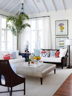 Reverse Color Go for the unexpected when adding color to a room. White walls and window treatments create a serene, clean look in this living room, while light blue brightens the ceiling. Stacked windows lead the eye to the living room's white exposed beams, putting the emphasis on the room's height.