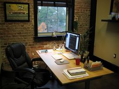 Cozy office space with red bricks
