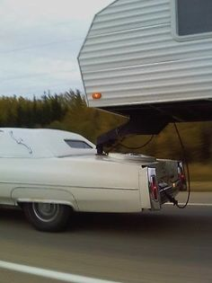 Cadillac towing a fifth wheel trailer