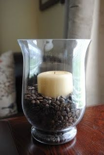 Love the smell of coffee? Surround a candle with coffee beans. The candle warms the coffee beans so your house smells lovely.