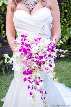Purple and white dendrobium orchid cascading bouquet. SunHorse Weddings, Isla Mujeres, Mexico. Photos by www.mandjphoto.com