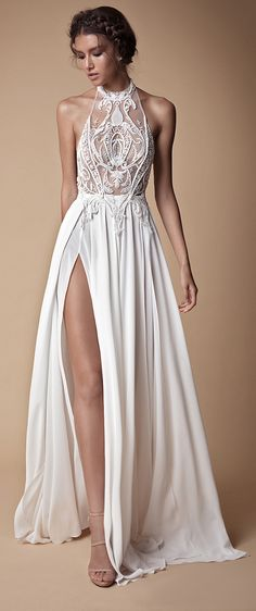 Gorgeous halter neck wedding gown with absolutely stunning embroidery details and high thigh side slit // The second Muse collection from Berta bridal is sexy yet sweet and features sheer fabrics, illusion bodices, intricate lace, wispy tulle, floral embroidery, high slits, skinny straps, plunging necklines, shimmering details, collared bodices, and cold-shoulder sleeves.